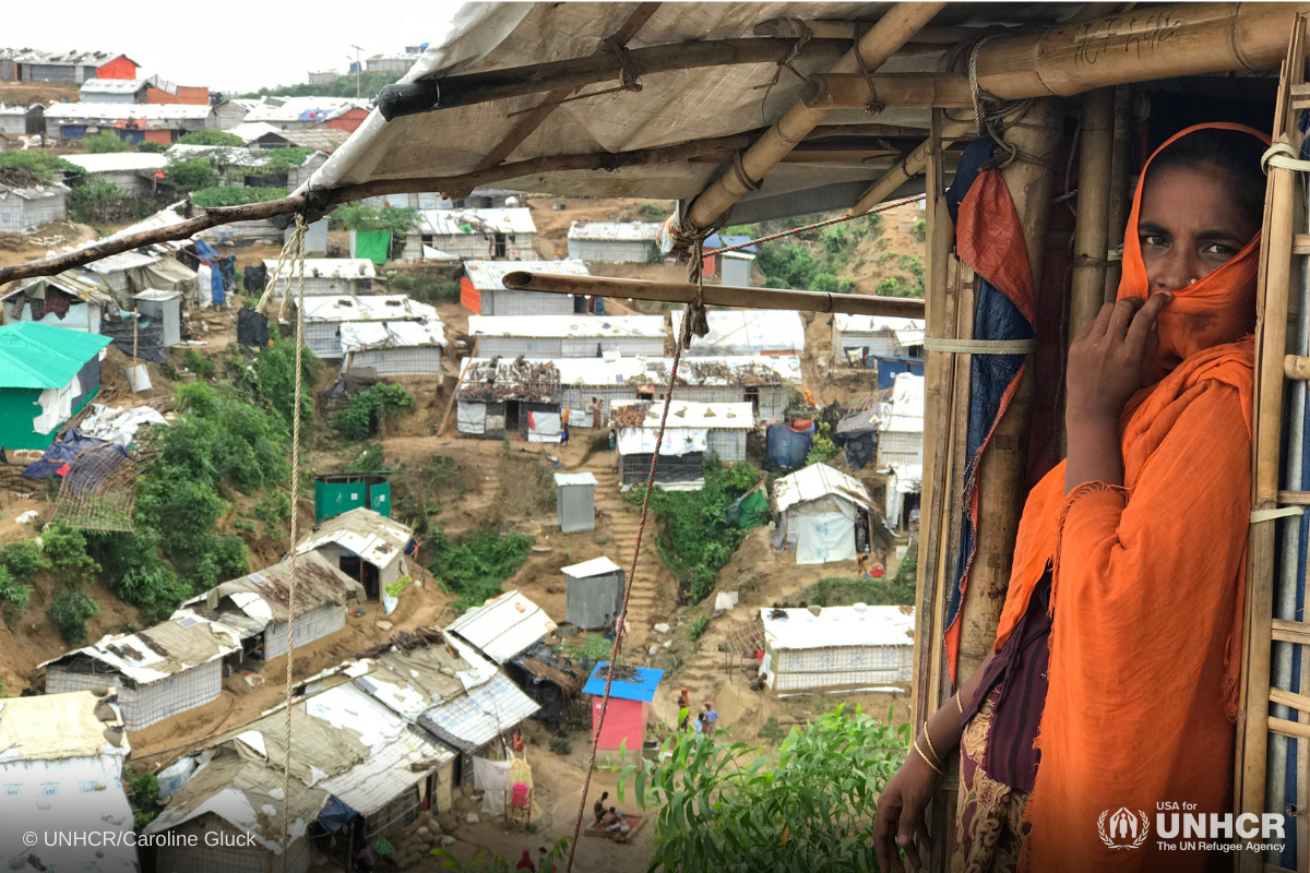 Rohingya women looks outside her shelter as heavy wind and rain causes landslides, flooding and damage to property in Cox's Bazar, Bangladesh